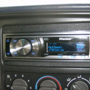 pioneer 6000 head with my ipod stashed in the flip up cd holder above the cup holder