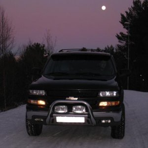 Nice evening picture with snow, and full moon in the background .........